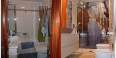 Una imagen para tu baño:  de estilo  de  MIKELY Decoradores de Interiorismo