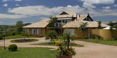 Projekty, rustykalne Domy zaprojektowane przez Carmen Saraiva Arquitetura