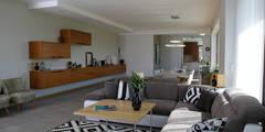 Salon de style de style Moderne par in2home