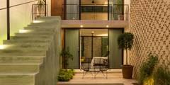 modern Houses by Taller Estilo Arquitectura