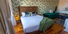 Dormitorios de estilo tropical de Sizz Design