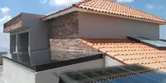 Residencia Hacienda San Antonio: Casas unifamiliares de estilo  por Arkisav