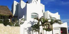 Villa Coquí Akumal: Villas de estilo  por DHI Arquitectos y Constructores de la Riviera Maya
