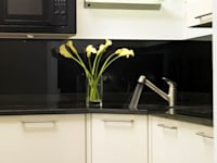 Cream High Gloss with Black Glass:   by Kitchen Co-Ordnation