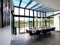 Rowood Farmhouse : modern Dining room by IQ Glass UK