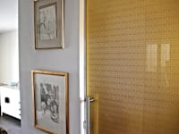 Golden glass door with bespoke pattern:  Glass doors by Alguacil & Perkoff Ltd.