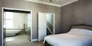 Master bedroom with ensuite bathroom: modern Bedroom by Affleck Property Services