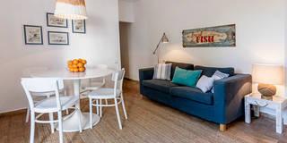 Sala - decoração de casa de férias:   por Home Staging Factory
