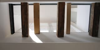 dachausbau_westend: minimalistische Esszimmer von heidenreich architektur