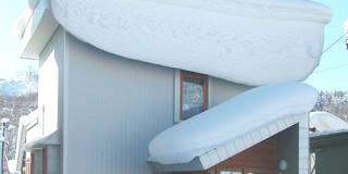 温室のある北国の家: ユミラ建築設計室が手掛けた家です。