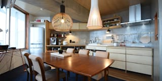 コンクリート張りのシンプルなキッチンスペース: 合同会社negla設計室が手掛けたです。
