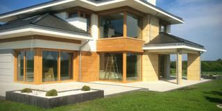 Dom z widokiem: styl nowoczesne, w kategorii Domy zaprojektowany przez MG Projekt Projekty Domów