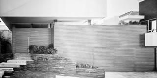 Casas de estilo moderno de Arqbox
