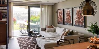 Salas de estar modernas por Esra Kazmirci Mimarlik