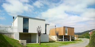 CASA MODULAR DE HORMIGÓN FRAN & RENATA: Casas de estilo moderno de ADDOMO