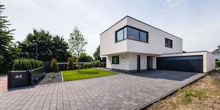 Maisons de style de style Moderne par Helwig Haus und Raum Planungs GmbH