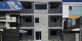 R Grey -永住したい打ち放しのマンション-: atelier mが手掛けたアプローチです。