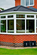 Guardian Warm Roof: modern Conservatory by Premier Roof Systems