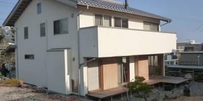 薪ストーブが吹き抜けの中心になる: T設計室一級建築士事務所/tsekkeiが手掛けた家です。