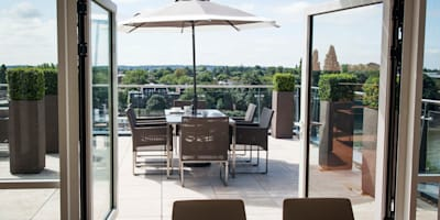 Somewhere to entertain:  Roof terrace by Cameron Landscapes and Gardens