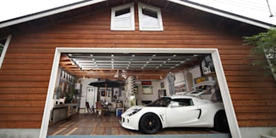 country Garage/shed by J-STYLE GARAGE Co.,Ltd.