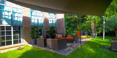 Sonnensegel in elektrisch aufrollbar  - Bad Harzburg: mediterraner Garten von Pina GmbH - Sonnensegel Design