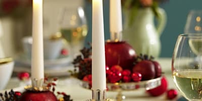 White tapered dinner candles:   by The London Candle Company