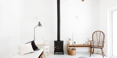 Estudios y despachos de estilo rústico de Arkstudio
