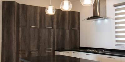 Cocinas de estilo minimalista por Excelencia en Diseño