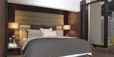 Camera da letto in stile in stile Moderno di Arq Renny Molina