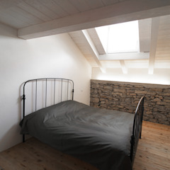 Chambre moderne par MIDE architetti Moderne