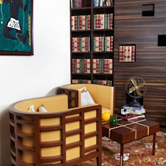 A silk Ikat rug in a library setting by Cocoon Fine Rugs