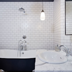 Industrial style bathrooms by NOMADE ARCHITETTURA E INTERIOR DESIGN Industrial