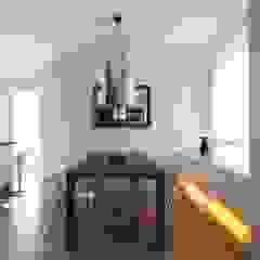 Minimalist dining room by SANSON ARCHITETTI Minimalist