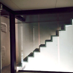 Industrial style corridor, hallway and stairs by Walter Emanuele Angelico, architetto Industrial
