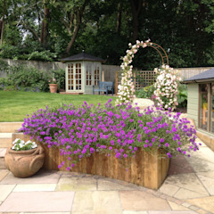 Rose arch with new paved seating area Roeder Landscape Design Ltd Country style garden
