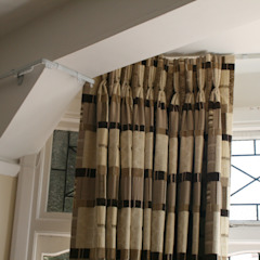 After: Curtains around complicated bay by Alf Onnie