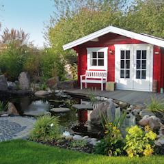 Pretty Log Cabin Country style garden by Garden Affairs Ltd Country