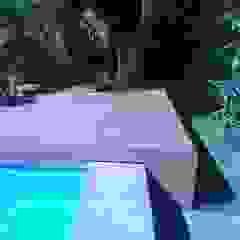 Piscinas de estilo tropical de Grupo Boes Tropical