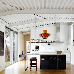 Industrial style kitchen by miba architects Industrial
