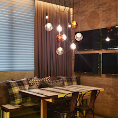 Industrial style dining room by Studio ro+ca Industrial