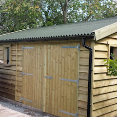 Feather edge wooden garage Colonial style garage/shed by Regency Timber Buildings LTD Colonial