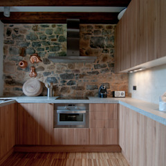 Country style kitchen by RUBIO · BILBAO ARQUITECTOS Country