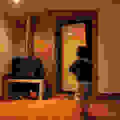 JOÃO SANTIAGO - SERVIÇOS DE ARQUITECTURA Rustic style living room Stone Orange