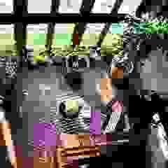 La casa del sasso Giardino d'inverno in stile rurale di ArchitetturaTerapia® Rurale Legno Effetto legno