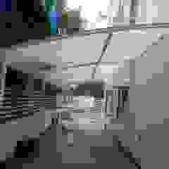 Poly Carbonate Sheet Car Parking Modern garage/shed by Fabritech India Modern