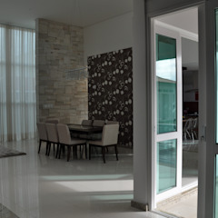 Modern dining room by Libório Gândara Ateliê de Arquitetura Modern
