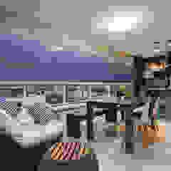 Balcones y terrazas eclécticos de Casa2640 Ecléctico