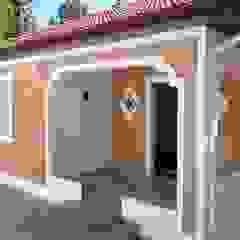 Rustic style house by Carmen Anjos Arquitetura Ltda. Rustic Bricks