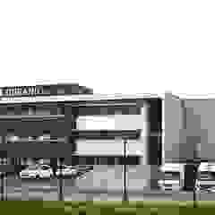 Industrial style office buildings by STUDIO D'ARCHITECTURE RANSON-BERNIER Industrial